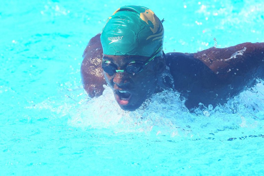 Junior Yohance Forde competes as a member of the ILS swim team.
