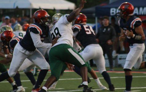 ILS defense attacks the quarterback. Photo Credit: Katia Perez-Sanchez