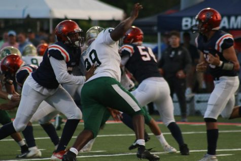 ILS defense attacks the quarterback. Photo Credit: Katia Perez-Sanchez