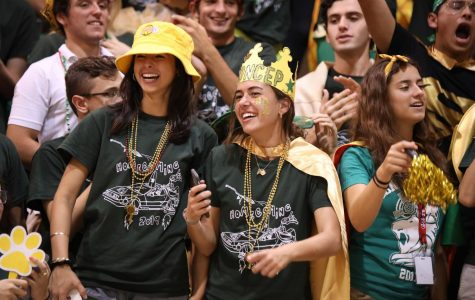 Seniors Mikayla Sanchez-Torrelio and Sofia Concepcion enjoying the Green & Gold pep rally during Homecoming.