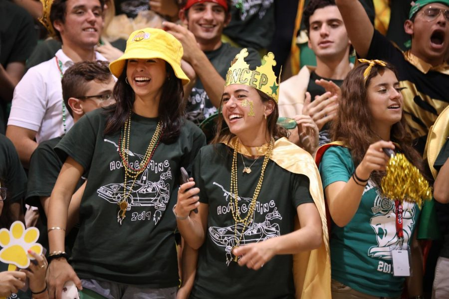 Class of 2020 Seniors Mikayla Sanchez-Torrelio and Sofia Concepcion enjoying the Green & Gold pep rally during Homecoming.