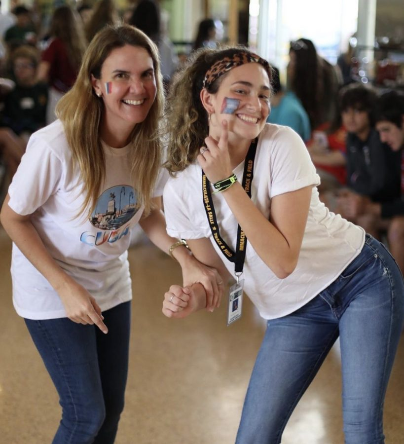 Senior Katia Perez-Sanchez and Ms. De La Rosa dancing the afternoon away at Feria Latina.