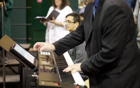 ILS's new music director Josue Cabrera lead the choir at Mass.