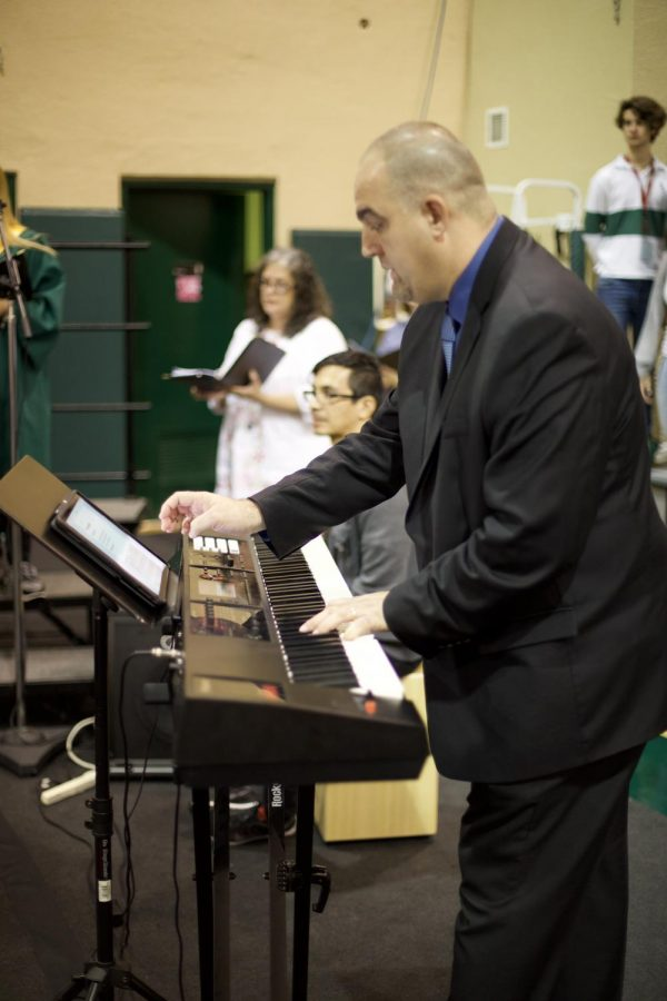 ILS's new music director Josue Cabrera lead the choir at Mass.