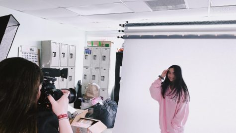 Junior, Sofia Farres working on a photo shoot for her company as a project for her STEAM elective.