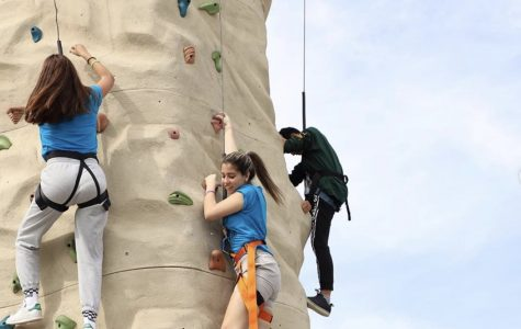 ILS students scaling the rock climbing wall during Don Bosco Day.
