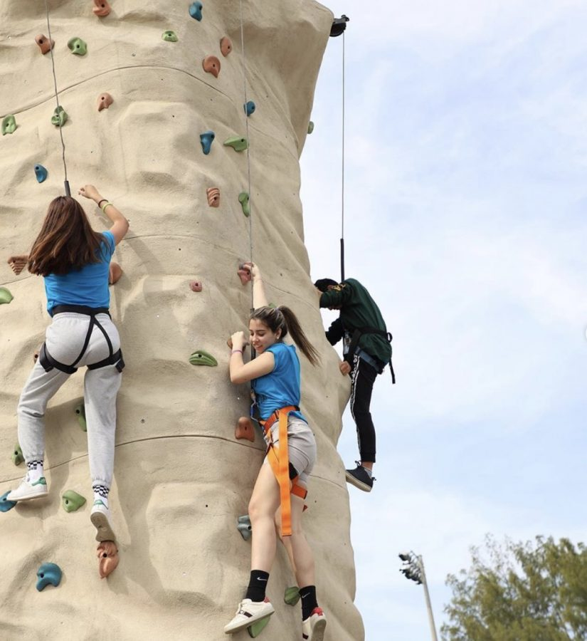 ILS+students+scaling+the+rock+climbing+wall+during+Don+Bosco+Day.