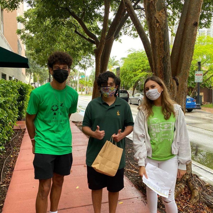 Seniors Maximus Betancourt and Melanie Remond delivering a goodie bag to their freshman.