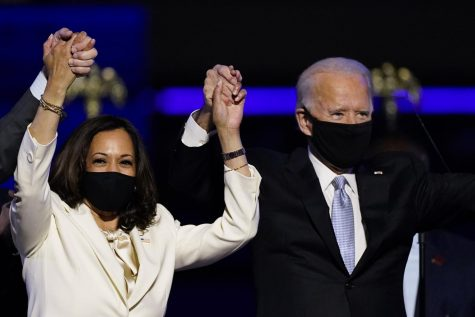 President Elect Joe Biden and Vice-President Elect Kamala Harris holding hands while giving their victory speeches Saturday, Nov. 7, 2020, in Wilmington, Del. (AP Photo/Andrew Harnik)